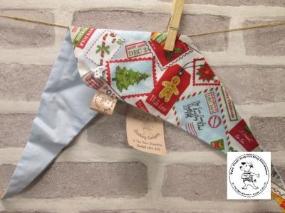 the posh dog clothing company Christmas bandannas small santa stamps pale blue 1