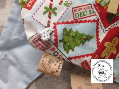 the posh dog clothing company Christmas bandannas small santa stamps pale blue 2